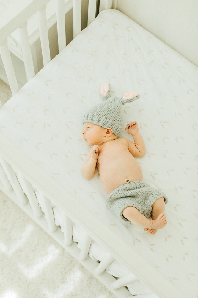 Baby in crib easter bunny outfit